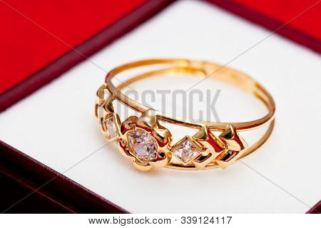 Fantastic Gold Ring Adorned With Several White Zirconia