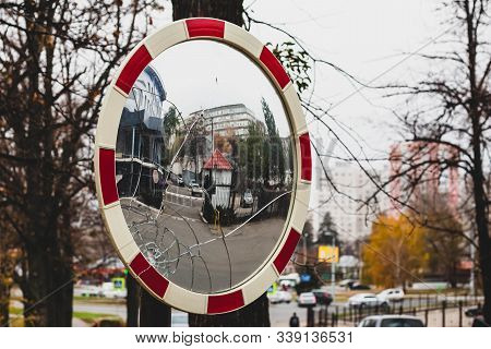 Spherical Road Mirror. Cracked On Convex Mirror. Traffic Concept