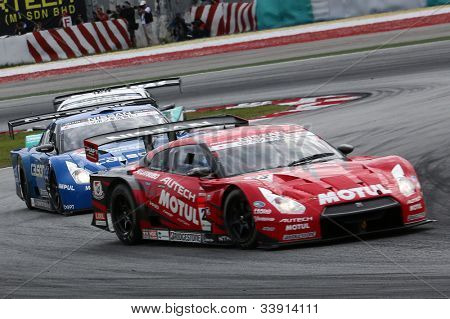 SEPANG - JUNE 10: GT500 cars take turn 1 at the 2012 Autobacs SUPER GT Series Round 3 on June 10, 2012 at the Sepang International Circuit, Malaysia. This race is part of the Japan GT series.