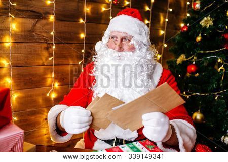 Santa Claus Is Preparing For Christmas, Reading Childrens Letters. Mail Of Santa Claus.