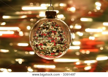 Christmas Ornament With Spinning Tree In Background