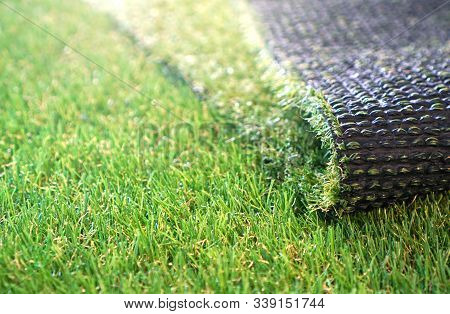 Greenering With An Artificial Grass. Artificial Turf Background.