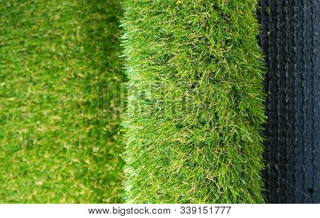 Roll Of Soft Artificial Grass. Luxury Artificial Turf Background.