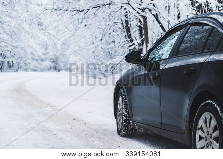 Car In Winter In Nature Outside The City. Snow Picture. Snow On The Road. Winter Road. The White Tre
