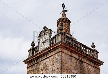 Detail Of The Clock And Windvane On The The Se Or Cathedral Church Tower In The Old Town Of Viseu