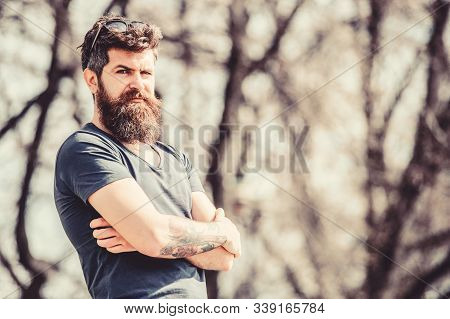 Masculinity And Manliness. Man Attractive Bearded Hipster Posing Outdoors. Confident Posture Of Hand