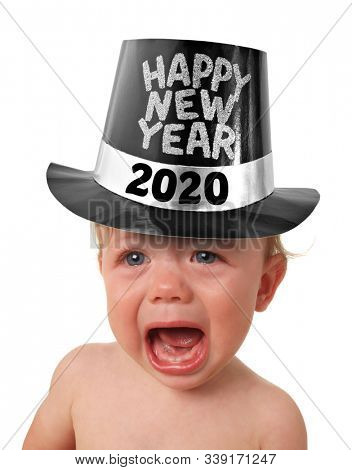 Crying unhappy New Year baby. Sad baby wearing a Happy New Year 2020 tophat.