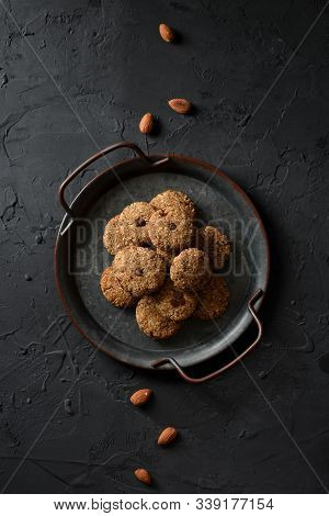 Vegan Sweets Concept. Almond Cookies With Chocolate Drops In Vintage Metal Tray And Whole Almond Nut