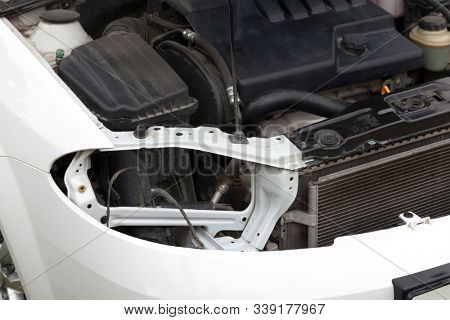 Malfunctioning car with opened hood