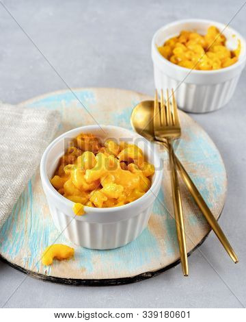 Macaroni And Cheese In Two Cups On Light Background