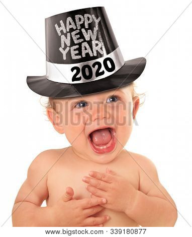 Happy New Year 2020 baby boy. Happy smiling toddler wearing a tophat