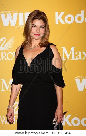 LOS ANGELES - JUN 12:  Laura San Giacomo arrives at the City of Hope's Music And Entertainment Industry Group Honors Bob Pittman Event at Beverly Hilton Hotel on June 12, 2012 in Beverly Hills, CA