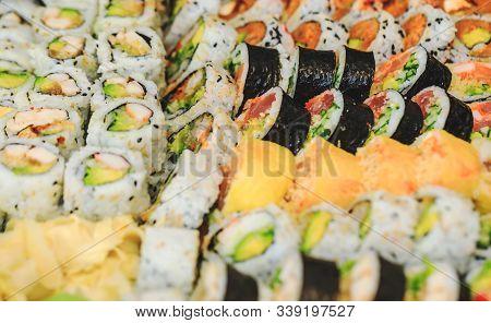Sushi Rolls With Salmon, Avocado, Tuna And Cucumber. Fresh Maki With Rice And Nori. Delicious Japane