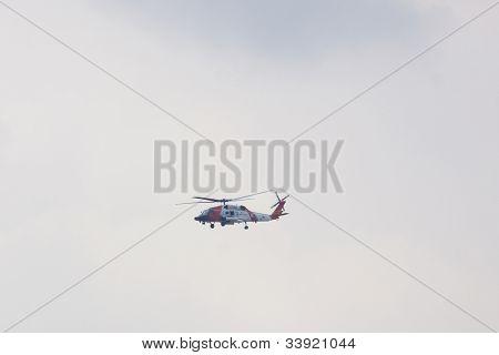 HOBOKEN, NJ - MAY 23: A USCG helicopter flies along the Hudson River near Manhattan during the Parade of Sails on May 23, 2012 in Hoboken, NJ. The parade marks the beginning of Fleet Week.