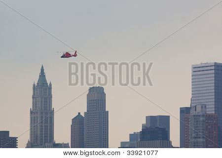 HOBOKEN, NJ - MAY 23: A USCG HH-65 Dolphin helicopter flies along the Hudson River above Manhattan during the Parade of Sails on May 23, 2012 in Hoboken, NJ. The parade marks the start of Fleet Week.