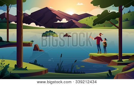 Father And Son On The Shore Of A Beautiful Lake In The Forest At Sunrise Or Sunset Overlooking The M
