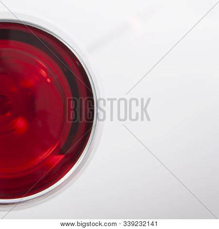 Glass Of Red Wine With Shadow.top View. There Is A Place For Text.