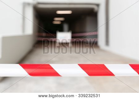 Soft Focus Of Red And White Barrier Warning Tape Sign That Mean No Entry Area For Safety.closed Pass