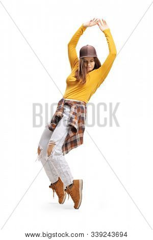 Full length shot of a female street dancer on tiptoes isolated on white background