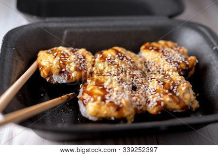 Warm Sushi In Package. Sushi With Eel In Unagi Sauce. Selective Focus