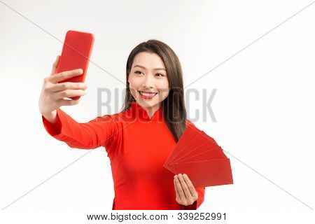 Beautiful Asian Women In Ao Dai Showing Angpao And Selfie With Phone On White Background,
