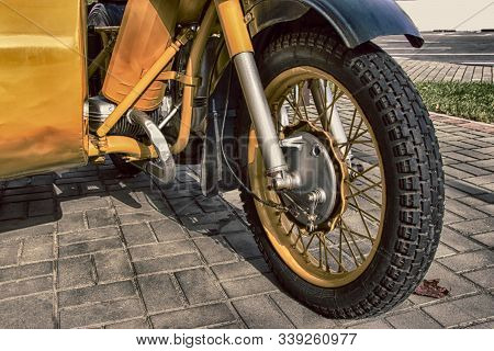 Old Yellow Motorcycle With A Sidecar. The Ancient Model.