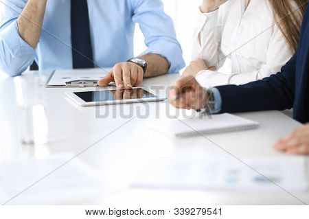 Group Of Unknown Business People Discussing Questions At Meeting In Modern Office, Close-up Of Hands