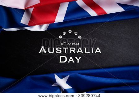 Australia Day Concept. Australian Flag With The Text Happy Australia Day Against A Blackboard Backgr