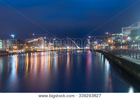 Dublin, Ireland - November 5, 2019: Liffey River With Samuel Beckett Bridge At Night.