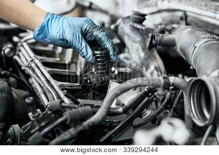 Professional Mechanic In Dirty Protective Gloves Testing Just Installed Nozzle Into Diesel Car Engin