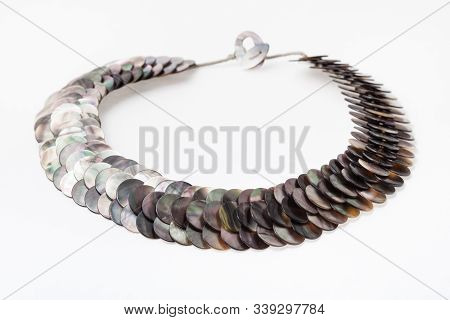 Necklace From Polished Natural Nacre Discs On White Paper Background