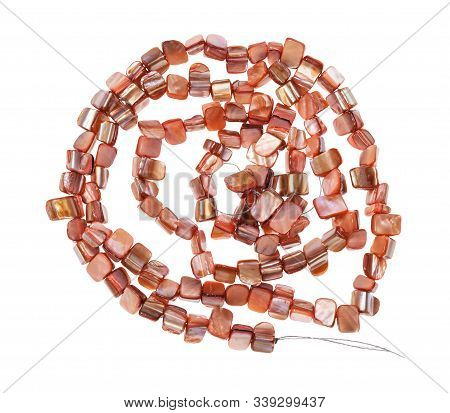 Top View Of Tangled String Of Beads From Natural Pink Pieces Of Mother-of-pearl Isolated On White Ba