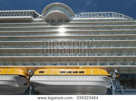 The View Of A Tender Boat Hanging On A Side Of The Large Cruise Ship Moored In Nassau (bahamas).