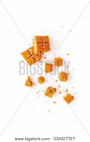 Salted Caramel Pieces - Paradoxical Sweets - On White Background Top View