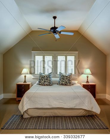 Simple extra upstairs bedroom above a garage.