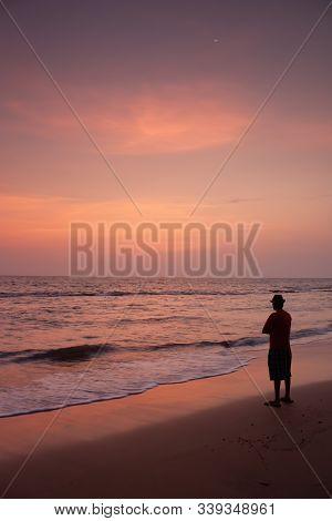 Susnet At Anjuna Beach Goa With A Man On The Beach