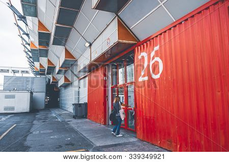 Woman Entering In One Of The Numbered Buildings Of The Exhibition Centre Of The Fiera Di Bologna Tra