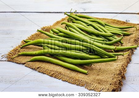 Phaseolus Vulgaris, Green Common Bean Or Kidney Bean On Rustic Sackcloth