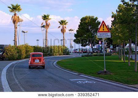 Koper, Slovenia-september 29,2019:vintage Red Car Zastava 750l (back View) Slowly Rides Along The St
