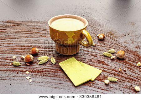 Coffee Cup, Chocolate With Matcha Tea, Hazelnuts, Cocoa Powder And Cardamon
