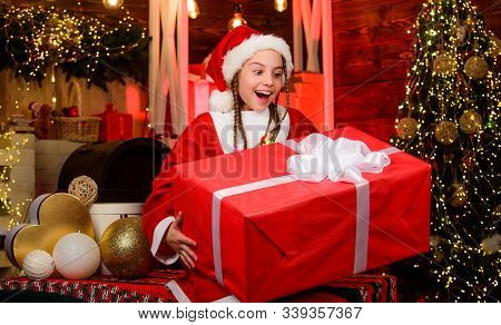 Child Having Fun Christmas Eve. Happiness And Joy. Girl Santa Claus Costume Received Gift. Santa Cre