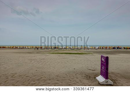 Cartagena,columbia-11/5/19: The City Beach Where Tourists Are Laying In Chairs Relaxing Under Colorf