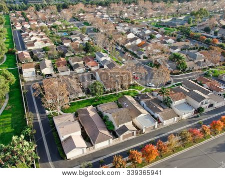Aerial View Of Middle Class Suburban Neighborhood With Houses Next To Each Other In Irvine, Californ