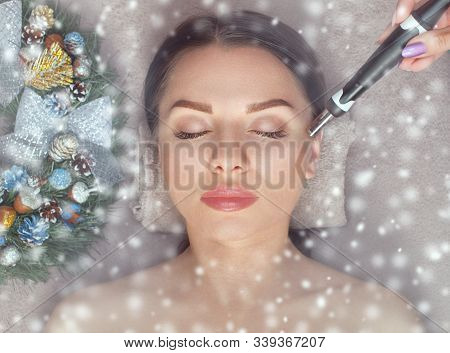 Beautician Makes Mesotherapy Procedure On Problem Skin Of The Face Of A Young Woman. Next To Her Are