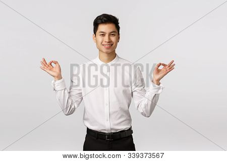 Peaceful And Carefree, Smiling Relaxed Cute Asian Businessman In White Shirt, Pants, Formal Outfit,