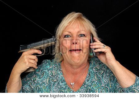Mature Blonde Woman With Cell Phone And A Handgun (3)