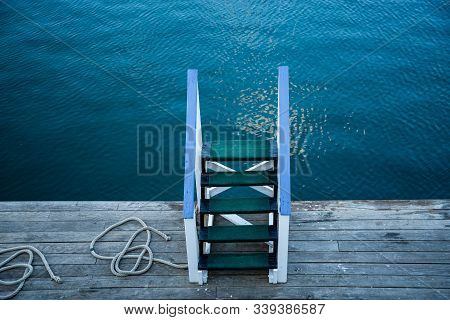 Wooden Stairs On The Deck Of A Ferry-ship