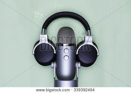 Microphon And Headphones On Mint Table With Gold Glitter - Top View Photo Of Professional Podcast St