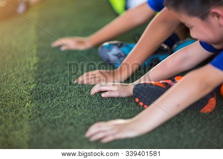 Children's Hands On Green Artificial Turf. Hand Sensitivity Test Competition.