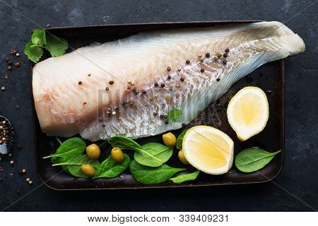 Fresh Cod Fillet Of White Sea Fish Before Cooking With Sea Salt, Olive Oil, Herbs And Pepper. Health